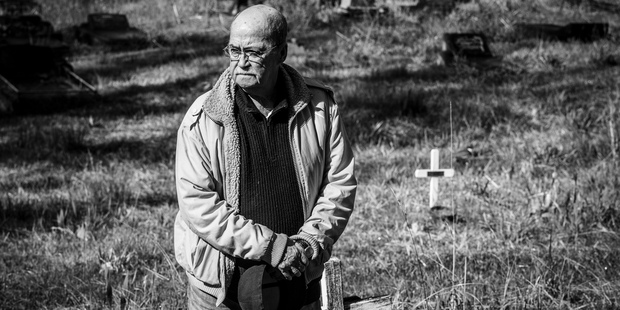 Pooch Quintal at Waikumete cemetery, looking for the unmarked grave of his friend Albert Black. Photo / Getty Images