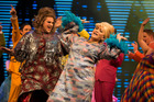 Colourful costumes and the performance of Lavinia Williams, centre, are among the many highlights of this updated version of <i>Hairspray</i>. Photo / Peter Meecham