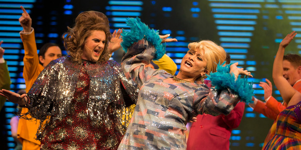 Colourful costumes and the performance of Lavinia Williams, centre, are among the many highlights of this updated version of  Hairspray . Photo / Peter Meecham