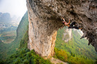 A climber tackles the famous archway of Moon Hill, in China's Yangshuo region. Photo / Derek Cheng