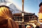 Elizabeth Carlson (left) takes a flying lesson over Wanaka. Photo / Elizabeth Carlson