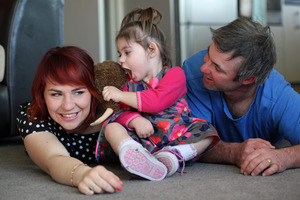 Ariana Lawn with her parents Cerise and Tim at their rural Opunake home. Photo / Glenn Jeffey