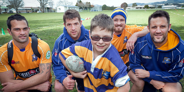 Tauranga Intermediate pupil Lucas Allen with Bay of Plenty Steamers players (from left), Jesse Acton, Johan Bardoul, Hamish Gosling and Josh Sole. Photo / Andrew Warner