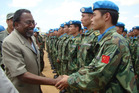 Joint AU-UN special representative Rodolphe Adada greets Chinese engineering unit members in Nyala. Photo / AP