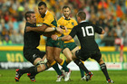 Kurtley Beale of the Wallabies is tackled during The Rugby Championship match between the Australian Wallabies and the New Zealand All Blacks. Photo / Getty.