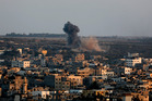 Smoke and dust rise after an Israeli strike hit Gaza City. Photo / AP