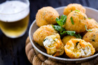 Arancini balls, in a Gidon Bing bowl from Everyday Needs. Picture / Babiche Martens