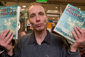 Author Nicky Hager with copies of his book, Dirty Politics.