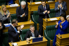 Finance Minister Bill English is congratulated by Prime Minister John Key and colleagues after reading his 2014 Budget. Photo / Mark Mitchell