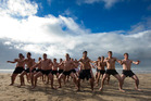 The Westlake Boys High School First XV rugby team perform a haka before taking a midwinter swim at Takapuna Beach. Photo / Brett Phibbs