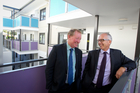 Housing Minister Nick Smith, left, and Housing NZ chief executive Glen Sowry look around a housing redevelopment in Three Kings in March. Photo / Richard Robinson