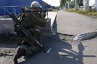 A pro-Russian rebel takes his position outside Donetsk, eastern Ukraine. Photo / AP