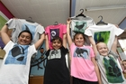 Greenpark School students Tyson Henare, 8, Jack Newton, 9, Jay Cooper, 8, and Dakota Filer, 8, show off the T-shirts they helped make to raise money for children in Cambodia. Photo / George Novak