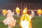 Stray fireworks from a pre-match pyrotechnics display struck three fans last night. Photo / Brett Phibbs