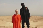 A video still released by ISIS that purports to show the killing of journalist James Foley. Photo / AP