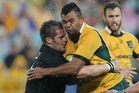 Richie McCaw clashes with Kurtley Beale. Photo / AP