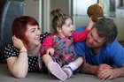 Ariana Lawn plays with her parents, Cerise and Tim, at their Opunake home. Photo / Glenn Jeffrey