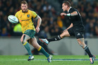 Aaron Cruden kicks the ball against the Wallabies at Eden Park. Photo / Getty Images