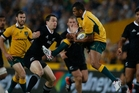All Black fullback Ben Smith and Wallaby Kurtley Beale clash during the drawn game in Sydney. Photo / Brett Phibbs