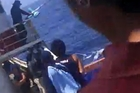 The video appears to have been filmed from the deck of a large vessel.