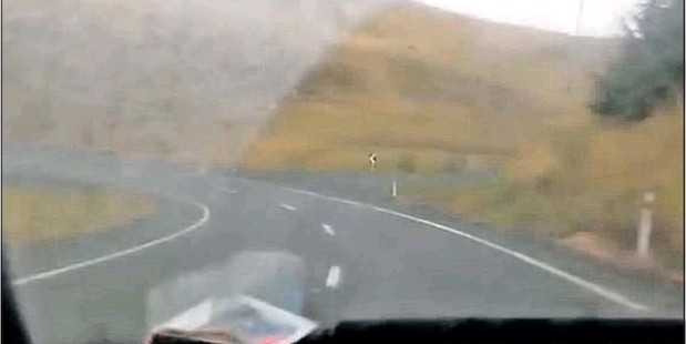 BUSTED: This still of the video posted on YouTube shows the car drifting on to the wrong side of the road. The post led to a conviction for a Napier man.