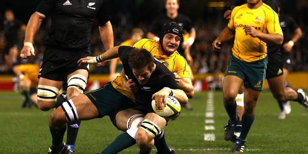 Richie McCaw scores one of the 10 tries during the 2010 Bledisloe Cup encounter. Photo / Getty Images