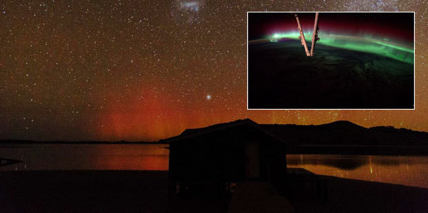 The aurora australis (southern lights), Photo / Otago Museum director Ian Griffin, and (inset) the aurora borealis (northern lights) captured from the International Space Station. Photo (inset) / Nasa