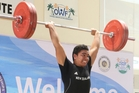 MAGS student Isaiah Papali'i on his way to gold at the Oceania Weightlifting Champs in April.