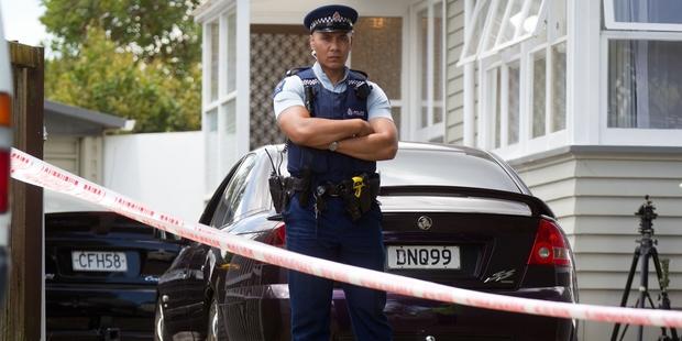 Police outside the Manurewa house. Photo / Richard Robinson