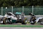 Nico Rosberg, right, touches the Mercedes of teammate Lewis Hamilton, causing a puncture that ruined his chance of winning. Photo / AP