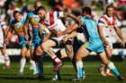 Josh Dugan of the Dragons is tackled during the round 24 NRL match between the St George Illawarra Dragons and the Gold Coast Titans. Photo / Getty Images