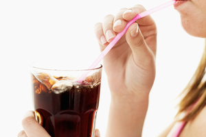 Slurping sugar filled soft drinks is not helping with the battle of the bulge. Photo / Thinkstock