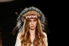 A model showcases a Trelise Cooper design with a feathered headdress. Photo / Getty Images