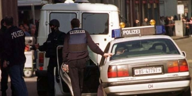 Police at the scene of the slaying in Basel, Switzerland in 2000.