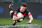 Mitchell Drummond scores one of Canterbury's six tries against Northland last night. Photo / Getty Images