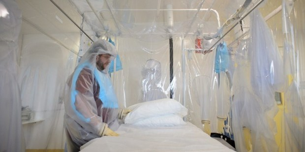 A shows a nurse wearing protective clothing as he demonstrates the facilities in place at the Royal Free Hospital in north London, ahead of the Ebola patient's arrival. File photo / AP
