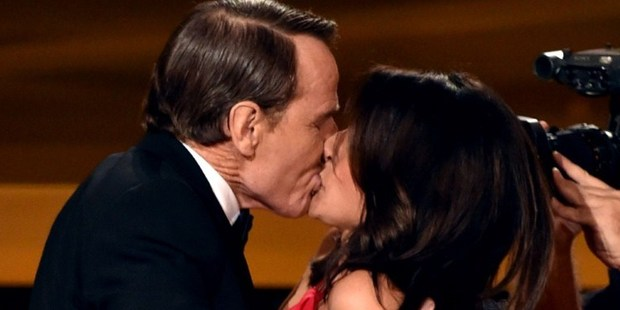Actress Julia Louis-Dreyfus (right) wins Outstanding Lead Actress in a Comedy Series for 'Veep' and kisses actor Bryan Cranston (left) onstage at the Emmys. Photo / AFP