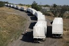 Trucks marked as being from a bitterly disputed Russian aid convoy to Ukraine stand in line as they return to Russia on the border post at Izvaryne, eastern Ukraine. Photo / AP