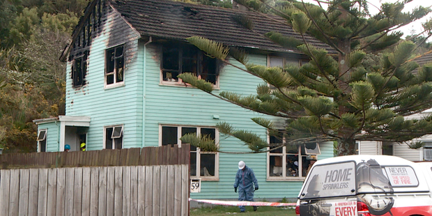 Loading Police and Fire forensic investigators at a fatal house fire at Titahi Bay. Photo / SNPA / Sam James