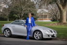 Barbara Harris, Deputy Director Trade and Hon. Vice Consul, UK Trade & Investment at the British Consulate-General in Auckland. With her car, a 2009 silver Mercedes SLK 350.