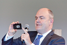 Steven Joyce snaps a photo for Instagram during a public meeting in Tauranga today. PHOTO/ANDREW WARNER