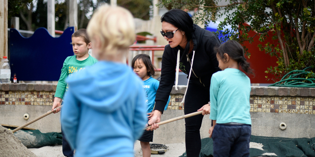 Gate Pa preschool teacher Amy Marsh helps her charges make a volcano in the sandpit. Photo / George Novak