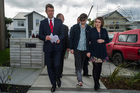 Labour's David Cunliffe talks to prospective home buyers Harry Smith and Jordy Leigh in Hobsonville yesterday. Turns out, they're not looking to buy. Photo / NZ Herald