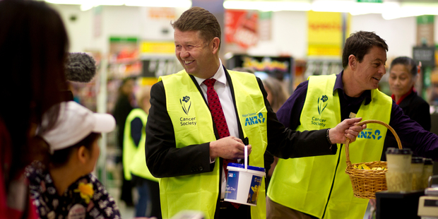 David Cunliffe collects for the Cancer Society during a walkabout at Lynn Mall. Photo / Dean Purcell