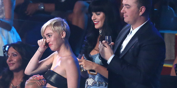 Miley Cyrus, left, tears-up as Jesse accepts the award for Video of the Year on her behalf at the MTV Video Music Awards. Photo / AP