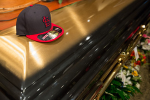 A St. Louis Cardinals baseball at rests on top of Michael Brown's casket before the start of his funeral at Friendly Temple Missionary Baptist Church in St. Louis. Photo / AP