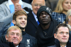 Liverpool's Adam Lallana, left, and Mario Balotelli in the stands during the English Premier League match at the Etihad Stadium, Manchester. Photo / AP