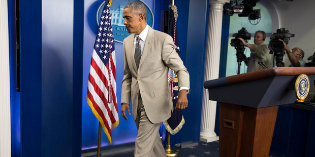 President Barack Obama leaves the White House in Washington in his tan suit. Photo / AP