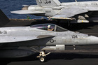 The United States is looking at airstrikes by fighter jets and bombers as well as sending special forces into Syria. Photo / AP