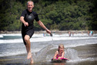 Andrew Matheson tows Cushla, 6, on her boogie board at Pauanui's beach. Photo / Christine Cornege